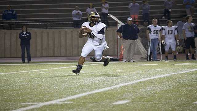 Quarterback Tre Edwards roll's out and reads the field. A solid option quarterback with a good arm, Edwards kept Westmoore on their toes.