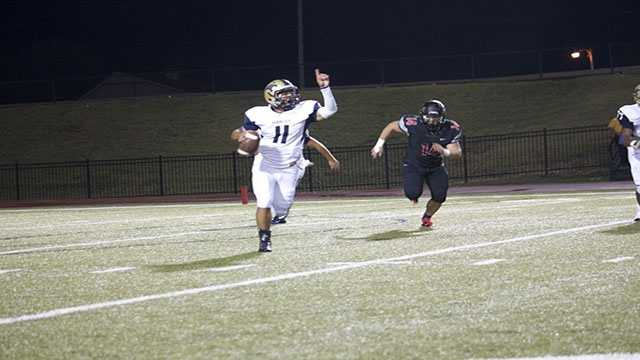Tre Edwards, quarterback, tries to signal his intent to pass.