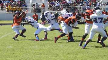 Chavez Wyatt (5), runs back a kick return as he tries to out-move opposing players.