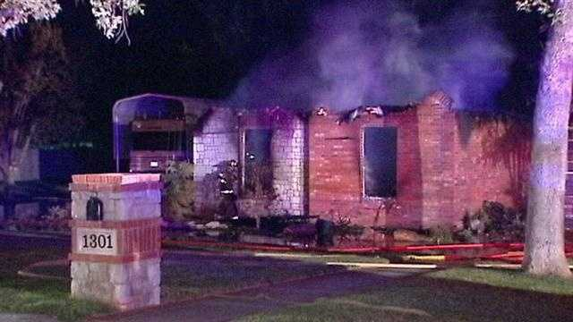 A woman escaped huge flames and explosions at a Northwest Oklahoma City home late Tuesday.