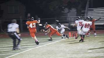 Tight end, Cal Schone (45) crosses the goal line for a touchdown reception that made gave the Tigers a 31-21 lead in their game Friday night against the Yukon Millers.