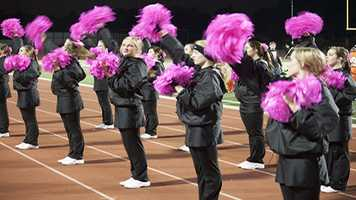 """The Norman High Pom squad traded out their usual pom-pom's for these Pink ones as """"Pink Out's"""" started this week. Expect to see plenty of pink gear on fans and athletes for the next month or so."""