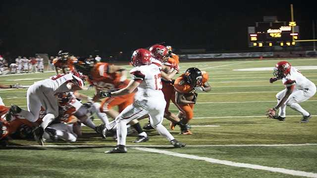 A'erion Hines (8) sneaks to the outside on a cutback to get to the end zone.