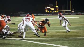 Mustang defenders attempt to stop Normans A'erion Hines (8) from getting into the end zone on a cutback rush.