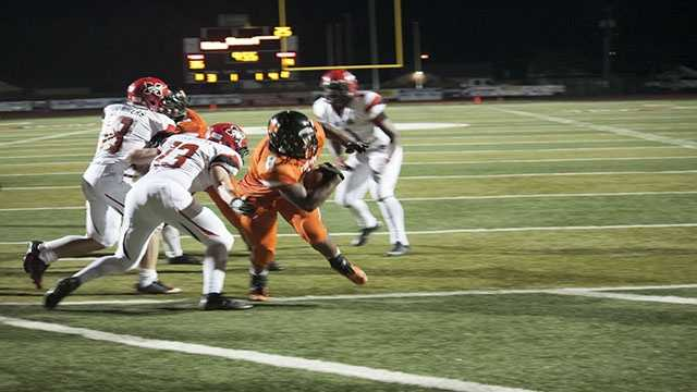 Hines (8) breaking the plane as he scores for Norman High.