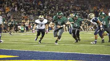Justice Hansen (11) scores for a rushing touchdown which would be one of the total seven combined the quarterback would provide for the night.