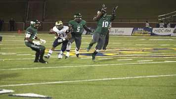 Santa Fe linebacker Jerremy Moore (10) jumps up for an interception.