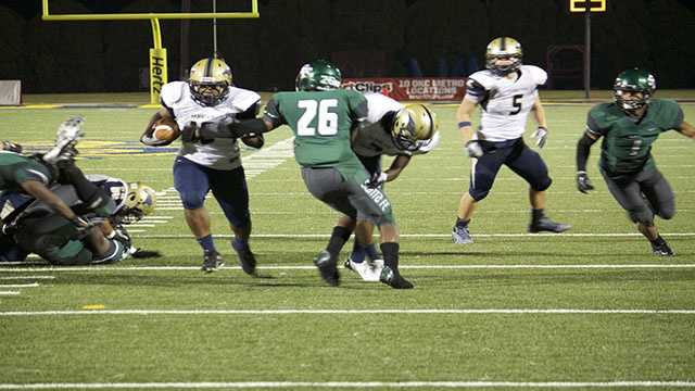 Pierce Spead (10) for Southmoore charges up the middle on this carry.