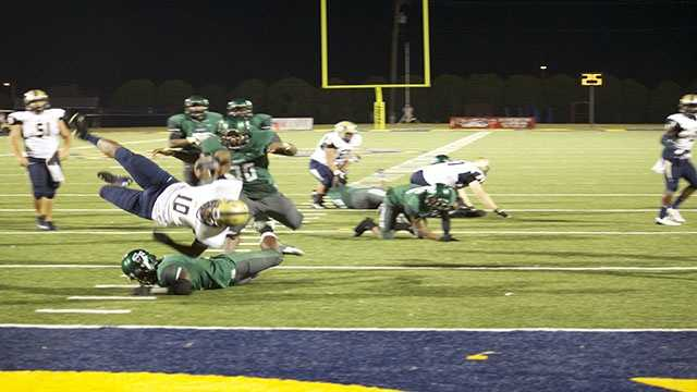 The Phillip Sumpter tackle takes the legs right out from under Spead who is sent crashing down.