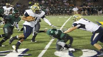 Sabercats quarterback Tre Edwards (11), goes airborne while trying to get all yards possible on a scramble.