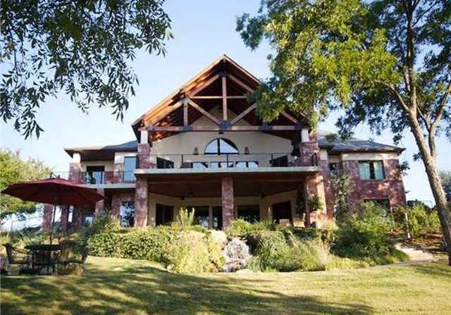 This four bedroom, six bath home was built in 2007. It features a game room, study and a wine room and sits on an 11 acre lot. You can find more information on this property at Realtor.com.