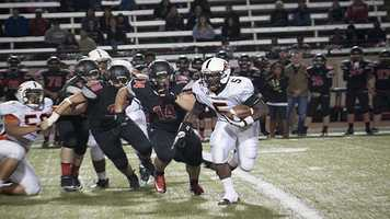Javone Knox (5) rushes to the outside while trying to add on more yards.