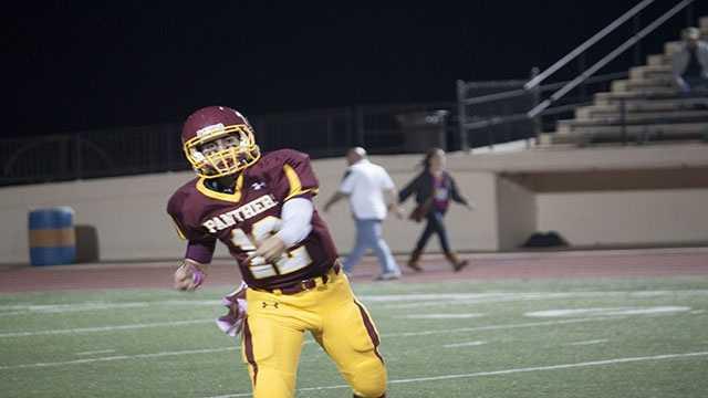 Quarterback John Simon (12) after throwing a pass.