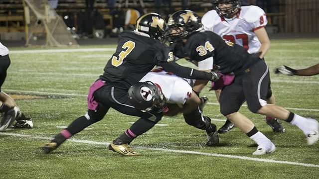 Two Midwest City players run into one another after Yukon quarterback, Zach Holliday (16), dives between the two.