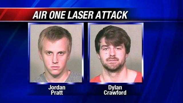 According to police, Jordan Pratt and Dylan Crawford pointed a laser at a police helicopter four times.