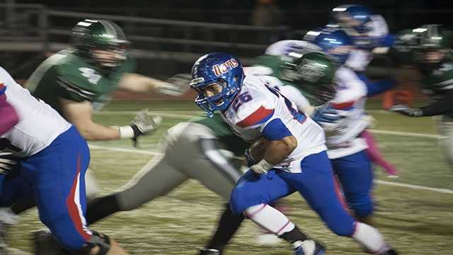 Moore running back, Keoni Walter (26), carries the ball on a rushing attempt.