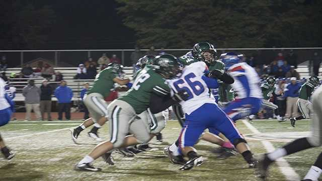 The Timberwolves offense holds off defenders. Norman North had a great showing against Moore, proven by their 54-0 final score.