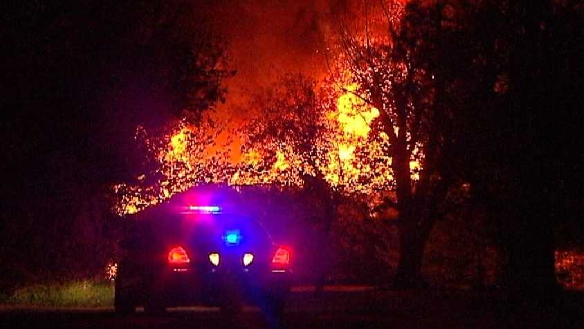 Firefighters are investigating huge flames that scorched a northeast Oklahoma City home Monday morning.