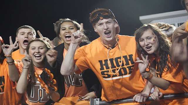 "The Norman High student section was a rowdy and loud bunch during this week's playoff game. Shirts that they wore to the game included a ""Tiger Up"" phrase, inspired by the Oklahoma City Thunder's 'Thunder Up' phrase."