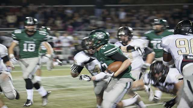 Channing Meyer (17) rushes out of the wildcat for Norman North to gain yards on the ground.