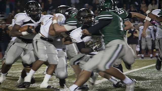 The Timberwolves defense provided constant pressure on the backfield, here Broken Arrow running back Devon Thomas (4) runs into a wall of bodies as the Timberwolves push back the Tigers offensive line.