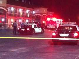 KOCO's Carla Wade snapped these photos from the Drover's Inn in southeast Oklahoma City. A man fired shots from the parking lot, striking a woman staying at the motel.