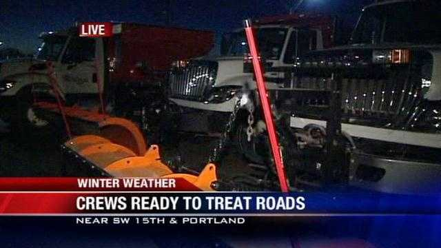Officials are watching the roads Monday and waiting to see if they need to be treated for the morning drive.