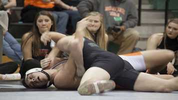 Norman North's Josh Bradley goes for the pin on opponent Collin Kappel. Bradley would win 14-3 on points and a 25-14 lead.