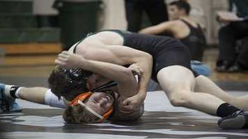 Norths Austin Wright (TOP) attempts to pin Norman opponent Jeffery Adams in a 132 weight class match. Adams would win on points.