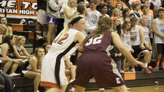 Albany Anderson (12) for Norman looks to pass while being pressured by Edmond Memorials Kaleigh Troxell (32).