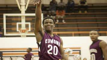 Bulldog player Aaron Young (20) is all grins after going 2-for-2 with free throws while at the line.
