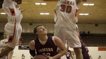 Tyler Holcomb (12) tries to time his shot while under the basket.