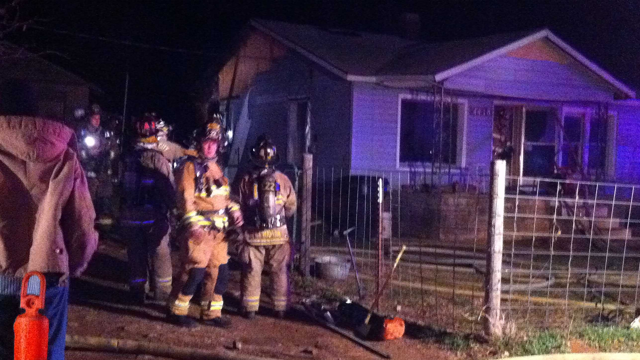 Firefighters battle a house fire in northeast Oklahoma City.