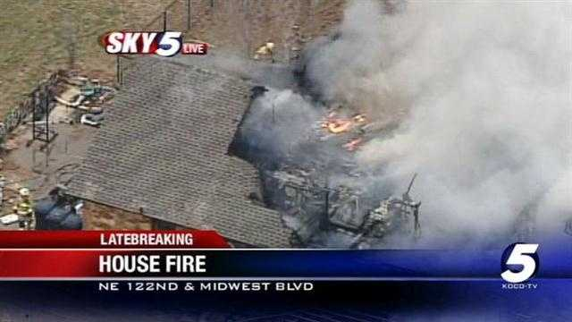 Fire crews were called to a home at Northeast 122nd Street and Midwest Boulevard after a house went up in flames.