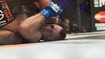 Dion Staring is on the painful end of an elbow from opponent Daniel Cormier.