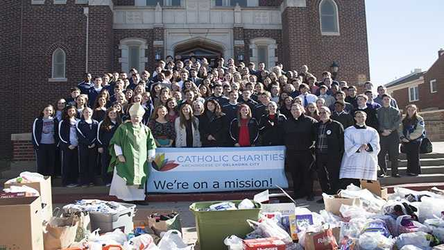 """From left to right: Cascia Hall, Bishop McGuinness, Bishop Kelley and Mount St. Mary boys and girls basketball teams who are participating in the """"Hoops 4 Hope"""" tournament Friday and Saturday."""