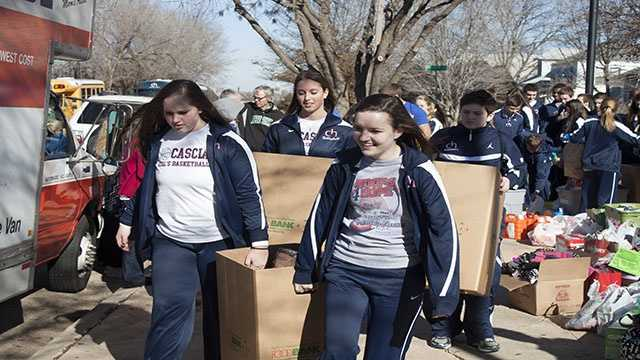 """Cascia Hall starts off the loading process for donations that were raised in preparation for the """"Hoops 4 Hope"""" event."""