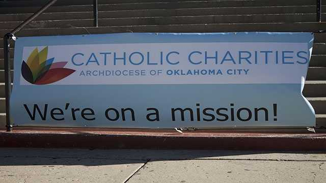 The Catholic Charities banner outside of Sacred Heart church.