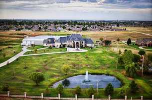 This house sits on 5 acres of land and has five bedrooms and 9 baths. Take a look at what's in the 6,200 square feet of living space. For more information on this property, click here.