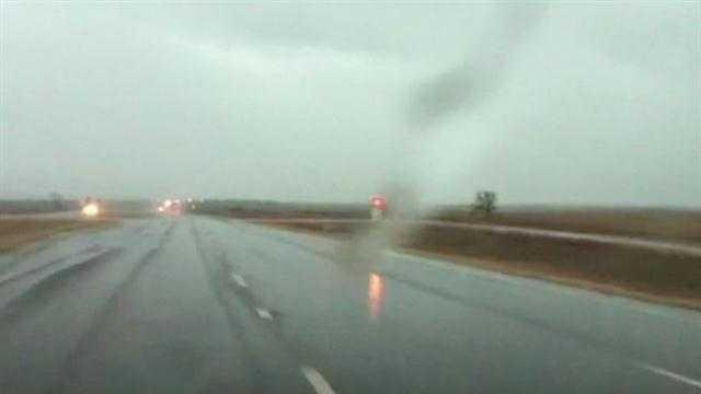 Rain falls south of Okarche and north of El Reno.