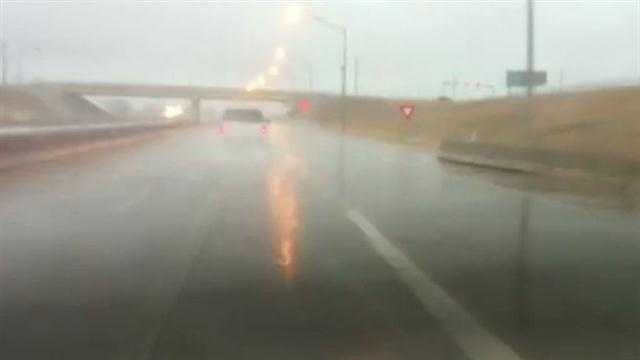 The rain was pouring down on the Kilpatrick Turnpike, near Broadway Extension, Tuesday morning.