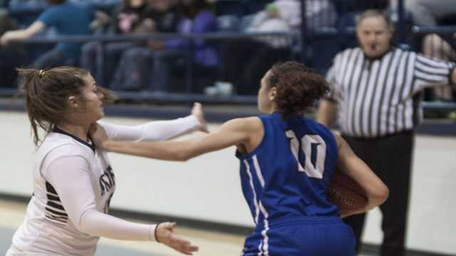 A McAlester player gets pushed-back by Shawnee player Kristen Grabin (10) during the Shootout tournament.