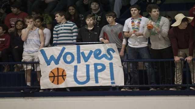 Fans got creative with signs that hung during the Shawnee Wolves and Lady Wolves first games that opened the shootout.