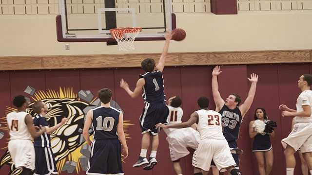 David Montgomery (1), leaps up to swat away the ball.