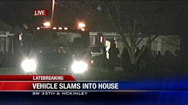 Truck slams into house