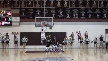 No need for Young to worry as teammate Shaquille Morris (23) grabbed the rebound and slammed it in for a nice dunk.