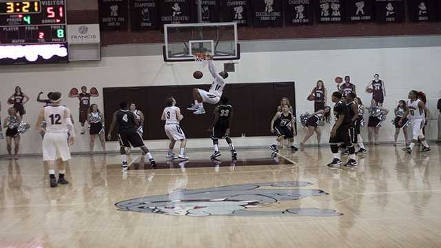 Shaquille Morris (23), slammed the ball through the hoop, with this awesome dunk by the senior center.
