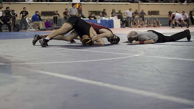 Tuttle's Austin Elam attempts to pin Luke Chapman of Madill during the 160 lbs. Class 4A consolation finals. Elam would win a 10-2 major decision for third place.