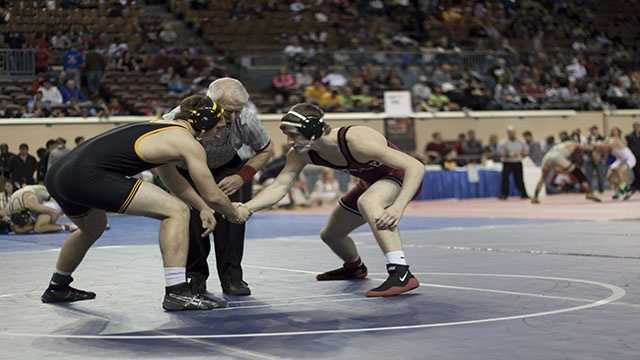 Madill's Luke Chapman (left) and Tuttle's Austin Elam (right) shake hands before their 160 lbs. Class 4A consolation match.
