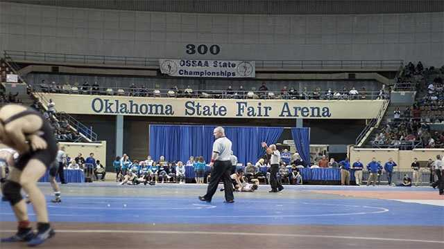 During the consolation finals wrestlers from Classes 3A up to 6A wrestled at the same time under the lights at the Oklahoma State Fair Arena.